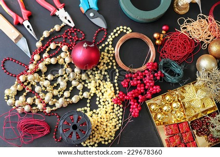Tools and decorations for making christmas wreath - stock photo