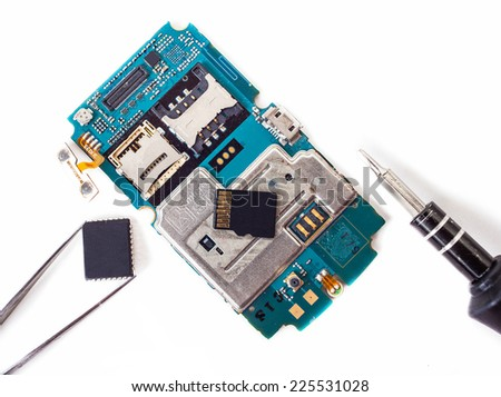 tools and disassembled phone memory cardon white isolated background