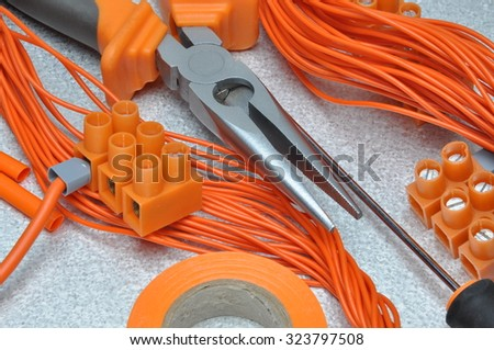 Tools and electrical component kit to use in electrical installations - stock photo