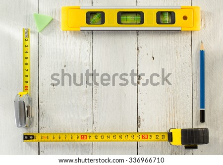 tools and instruments on wooden background - stock photo