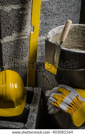 Tools bricklayer, bucket with a solution and a trowel, close-up - stock photo