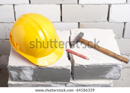 tools for a lot at a wall - stock photo