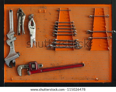 Tools for Car arranged on the wall - stock photo