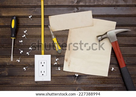 Tools for installation of electrical sockets and a sheet of paper for information. - stock photo