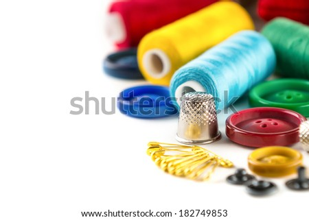 Tools for sewing and handmade: measurement, button, thimble, pins on white background