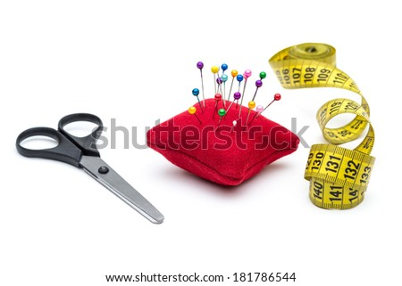Tools for sewing and handmade: thread, scissors, pins on white background - stock photo