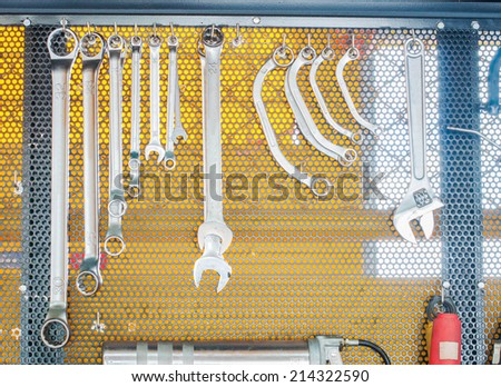 Tools hanging in workshop - stock photo