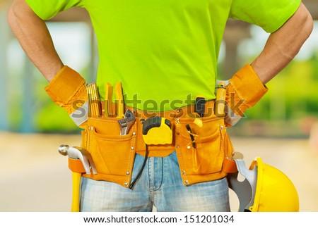 tools in belt of worker - stock photo
