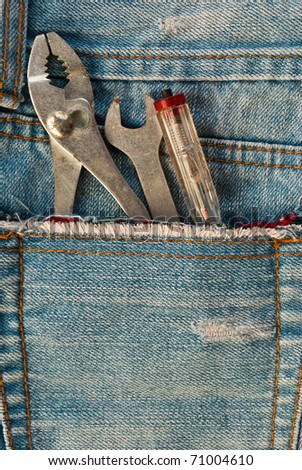 Tools in denim pocket. This tools are in blue jean is very classic and nice concept. - stock photo