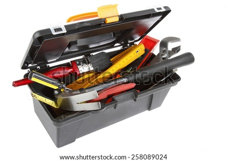 Tools in open toolbox on plain background