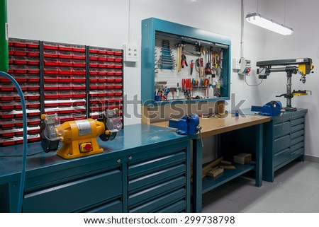 Tools in the board and in workshop. Workshop scene - stock photo