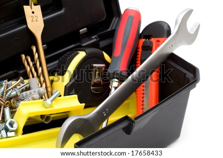 tools in the toolbox on white background - stock photo