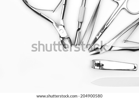 Tools of a manicure set on a white background  - stock photo