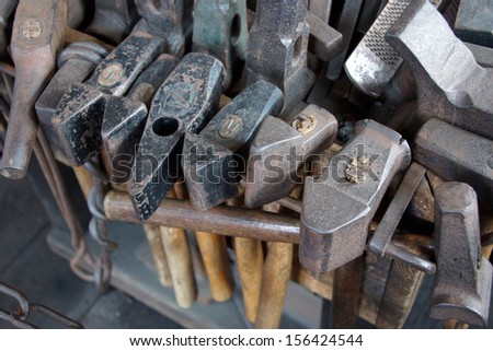 Tools of the blacksmith  in the only 19th century whaling smithy still operating.  Old Mystic Seaport, Connecticut  - stock photo
