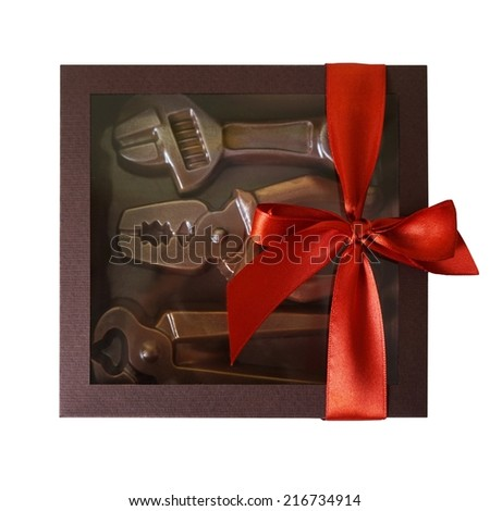 Tools of the chocolate in a gift box with a red bow. Great gift for men.  - stock photo