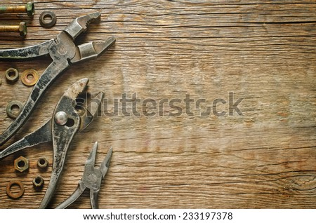 tools on a dark wood background. tinting. selective focus - stock photo
