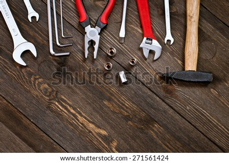 tools on a wooden background - stock photo