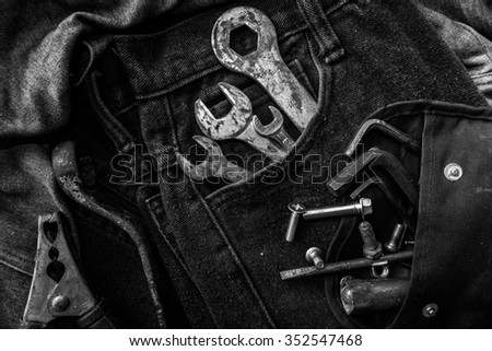 Tools on a workers pocket, Black and white photo
