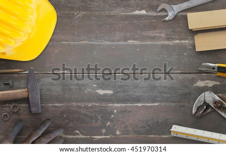 Tools on construction site table. Work desk with free space for text. - stock photo
