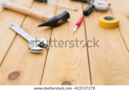 tools on the wooden background - stock photo