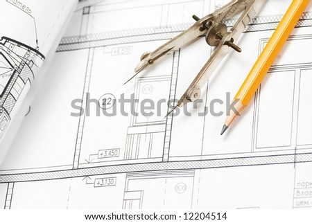 Tools over house plan blueprints - stock photo