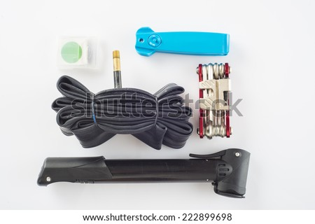 Tools set for cycling and to fix a flat tire isolated on a white background - stock photo