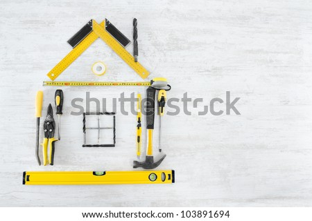 Tools Shape of House, Home Improve and Repair Concept. White Wooden Background - stock photo
