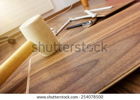 tools to laying laminate  - stock photo