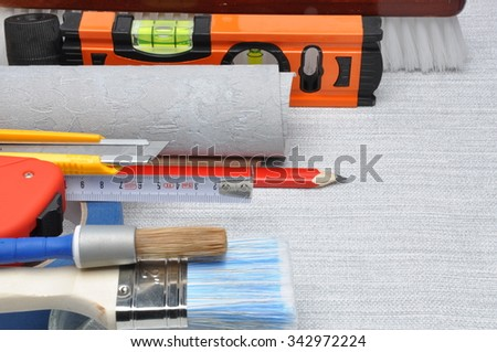 Tools used for wallpapering, renovation and repair at home - stock photo