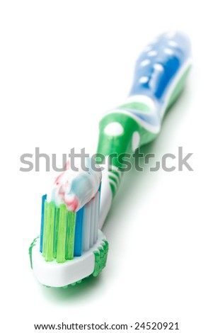 Tooth-brush and tooth-paste on a white background