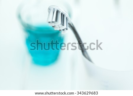 Tooth brush in glass and mouthwash