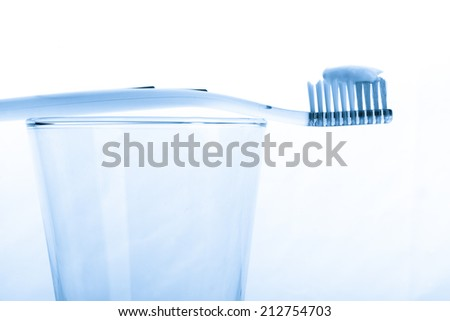 tooth brush in glass Isolated on white background