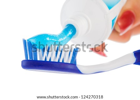 Tooth brush with tooth paste on white background - stock photo
