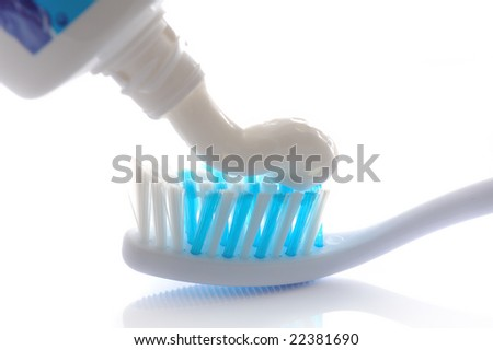 tooth brush with toothpaste on white