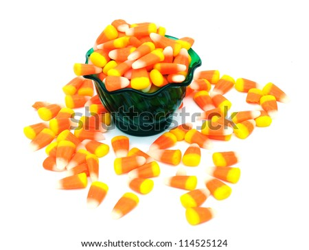 tooth candies on basket on white - stock photo