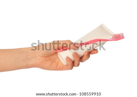Tooth-paste and brush at in the girl's hand