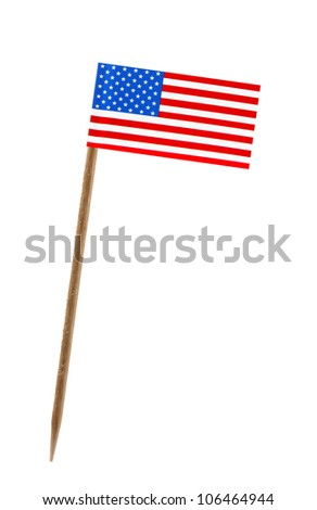 Tooth pick wit a small paper flag of United States of America, US - stock photo