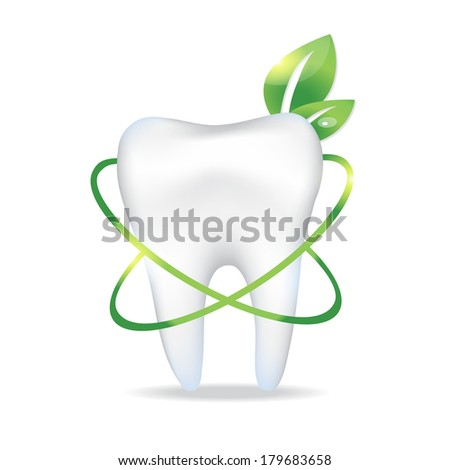 Tooth with leaf. - stock photo