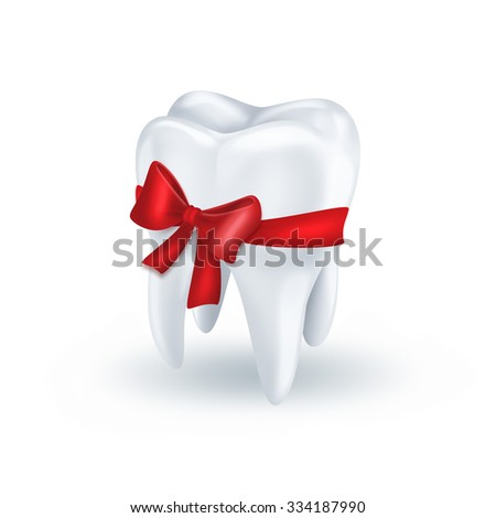 tooth with red bow on white background - stock photo