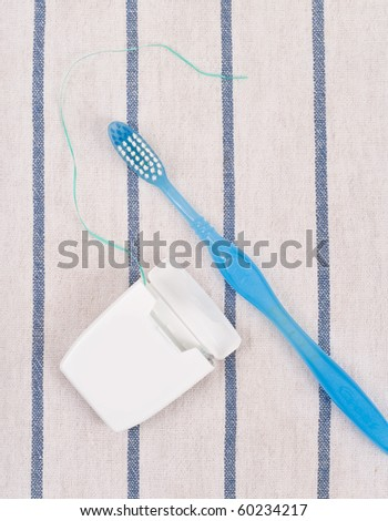 Toothbrush and Dental Floss - stock photo