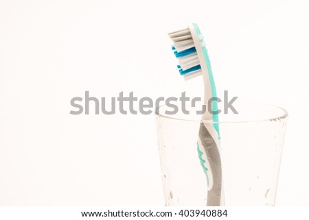 toothbrush and glass with white background