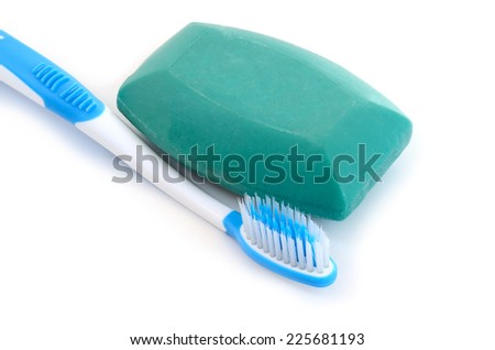 toothbrush and soap on white background