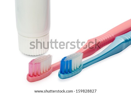Toothbrush and toothpaste in a white background