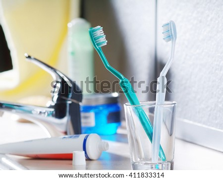 toothbrush and toothpaste on the sink - stock photo