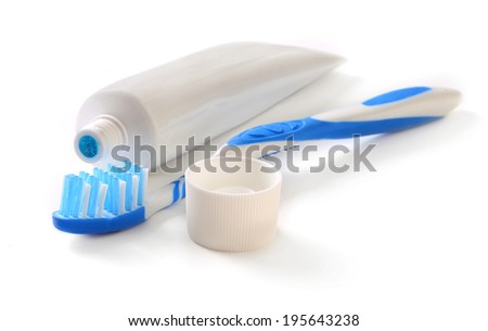 Toothbrush and tube of toothpaste - stock photo