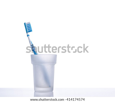 Toothbrush on a shelf with isolated background