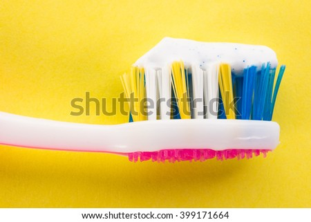 Toothbrush on a yellow background