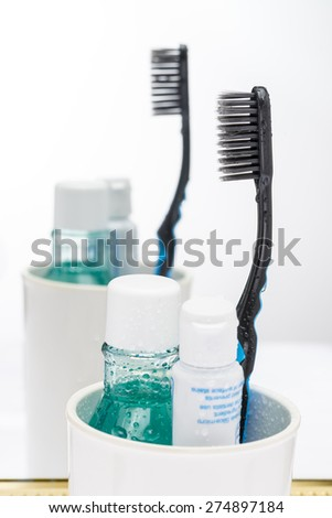 toothbrush, toothpaste and mouthwashes oral care  - stock photo