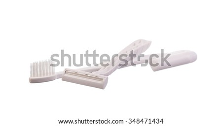 toothbrush, toothpaste and razor isolated on white background - stock photo