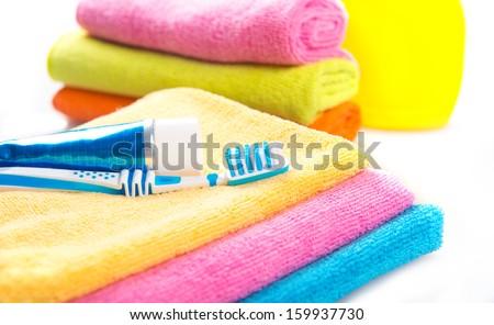 toothbrush, towel, toothpaste - stock photo